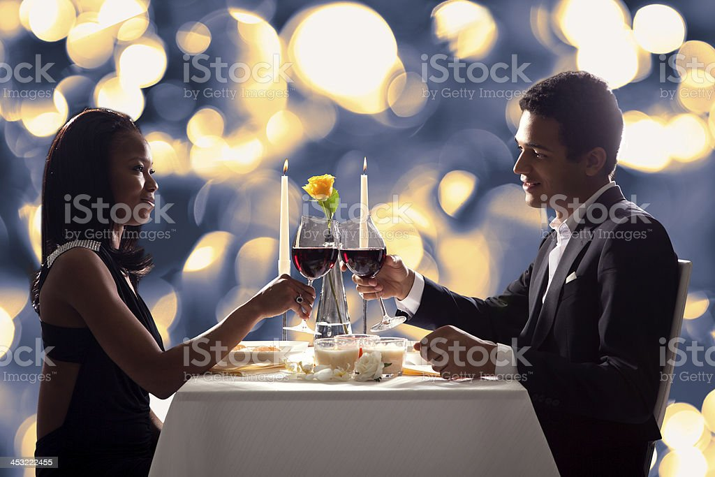 Romantic Couple Toasting Red Wine stock photo