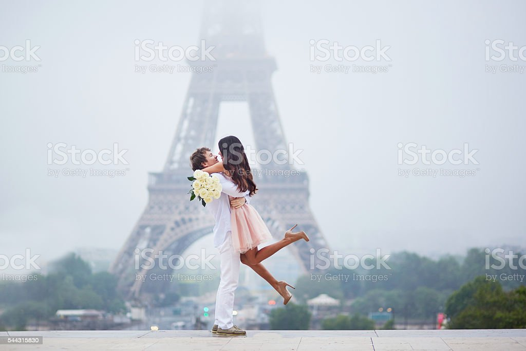 Romantic couple together in Paris stock photo
