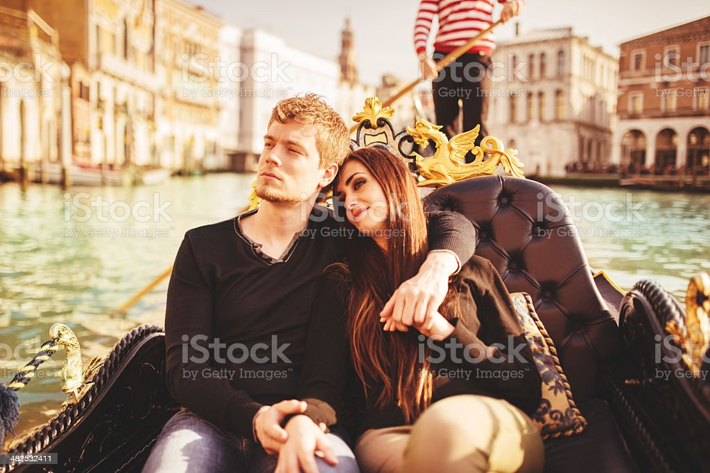 romantic couple togetherness on the gondola in venice royalty-free stock photo