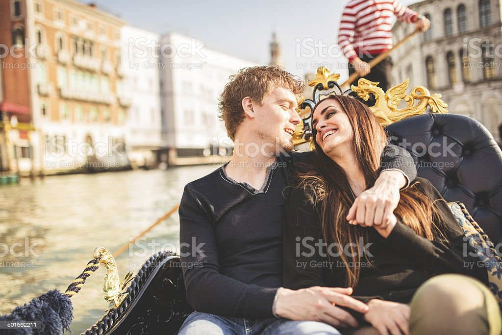 romantic couple togetherness on the gondola in venice stock photo
