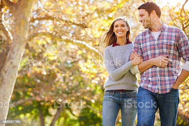 Romantic Couple Walking Through Autumn Woodland Stock Photo - Download Image Now