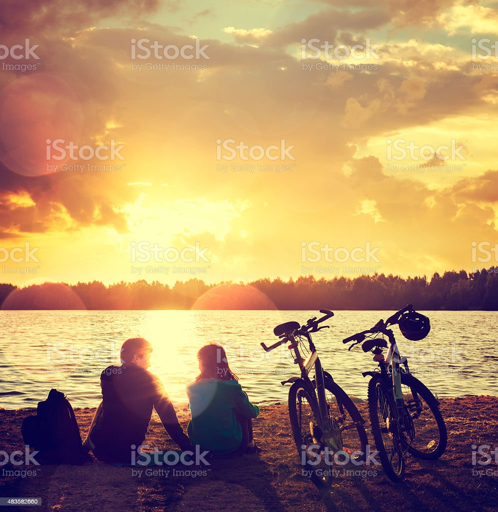 Romantic Couple with Bikes by the Lake stock photo