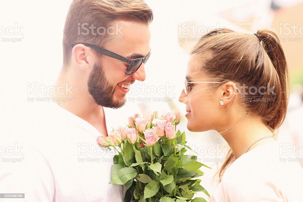 Romantic couple with flowers stock photo