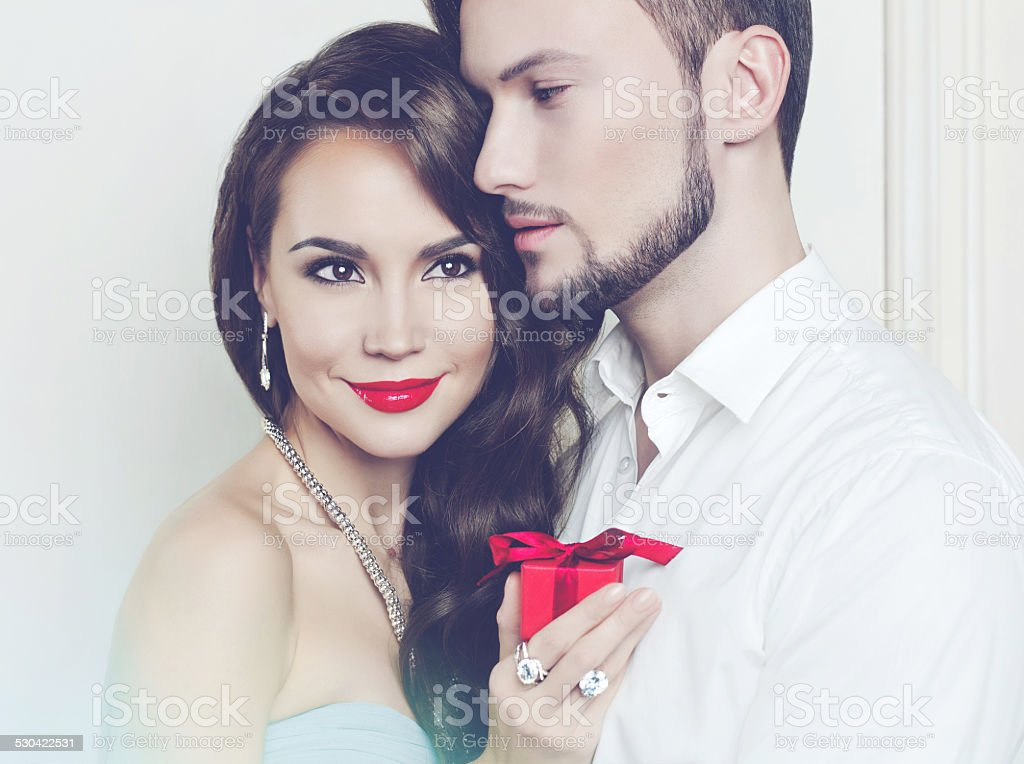 Romantic couple with gift stock photo