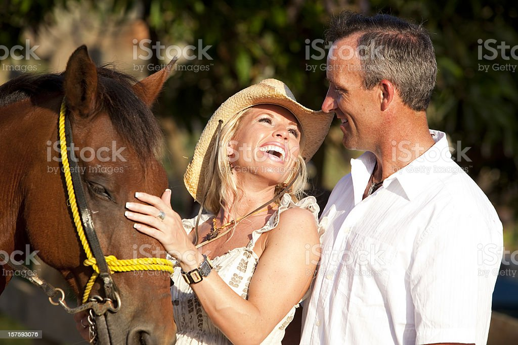 Romantic couple with horse royalty-free stock photo