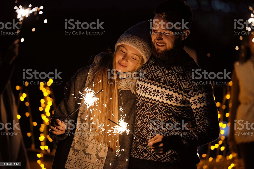 Romantic couple with sparklers stock photo