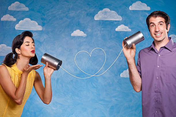 Romantic Couple With Tin Can Telephones stock photo