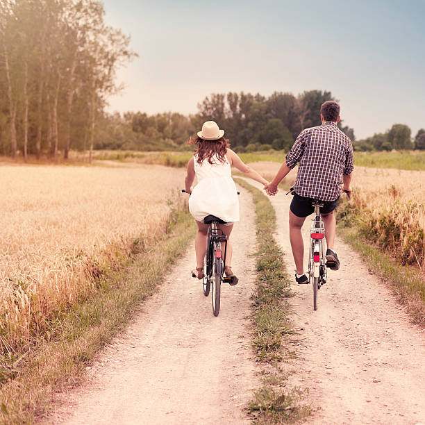 romantic cycling - love at first sight stock photos and pictures