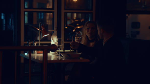 romantic date in restaurant - low lighting stock photos and pictures