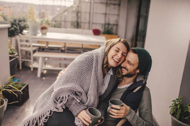 romantic date on our rooftop garden - couple lap stock photos and pictures