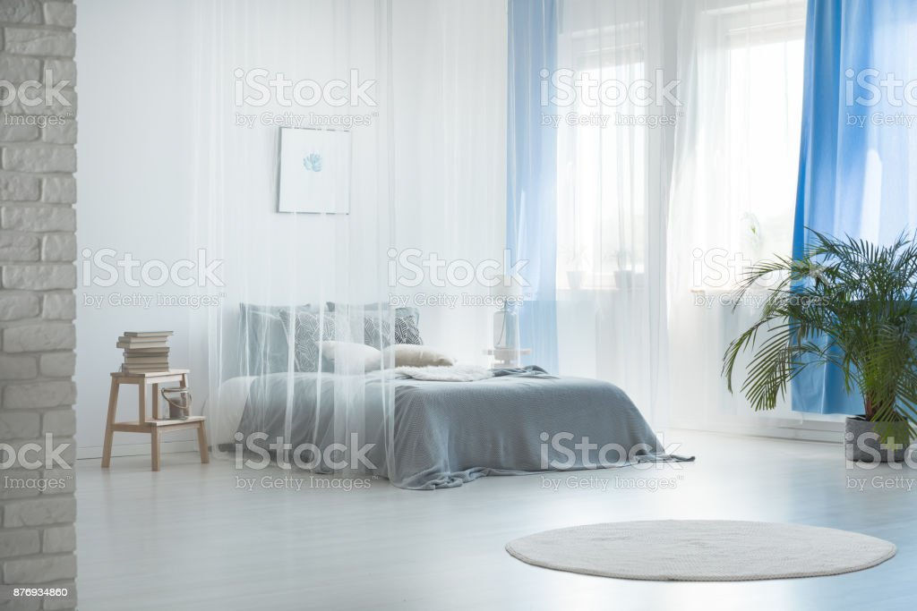 Romantic design of spacious bedroom stock photo