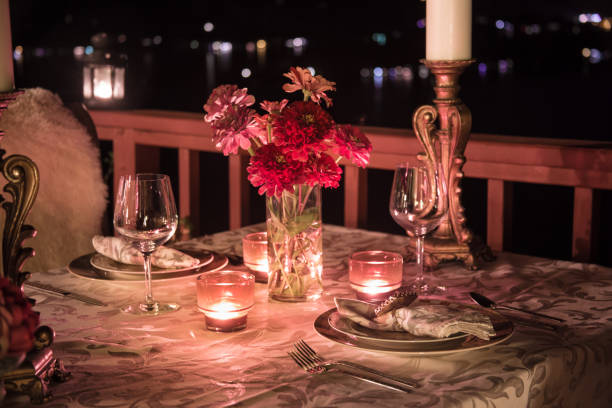 Romantic Dining at Night Candlelit Table Setting for Two with a View. table for two stock pictures, royalty-free photos & images