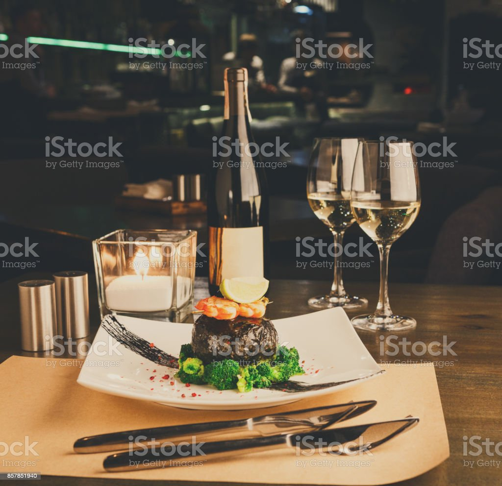 Romantic dinner at luxurious restaurant. Dorado fillet in nori w stock photo