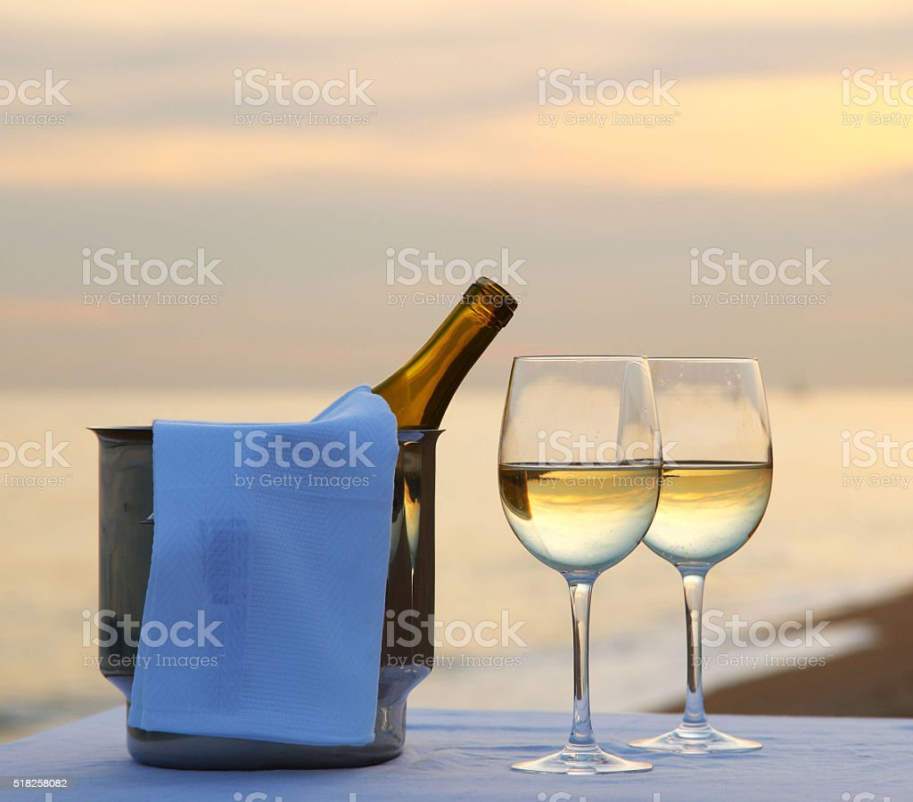 Romantic dinner at the beach stock photo