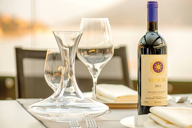 Romantic dinner at the sunset. Sassicaia wine served stock photo
