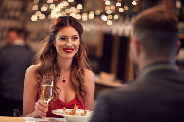 romantic dinner for valentine's day - dinner date stock photos and pictures