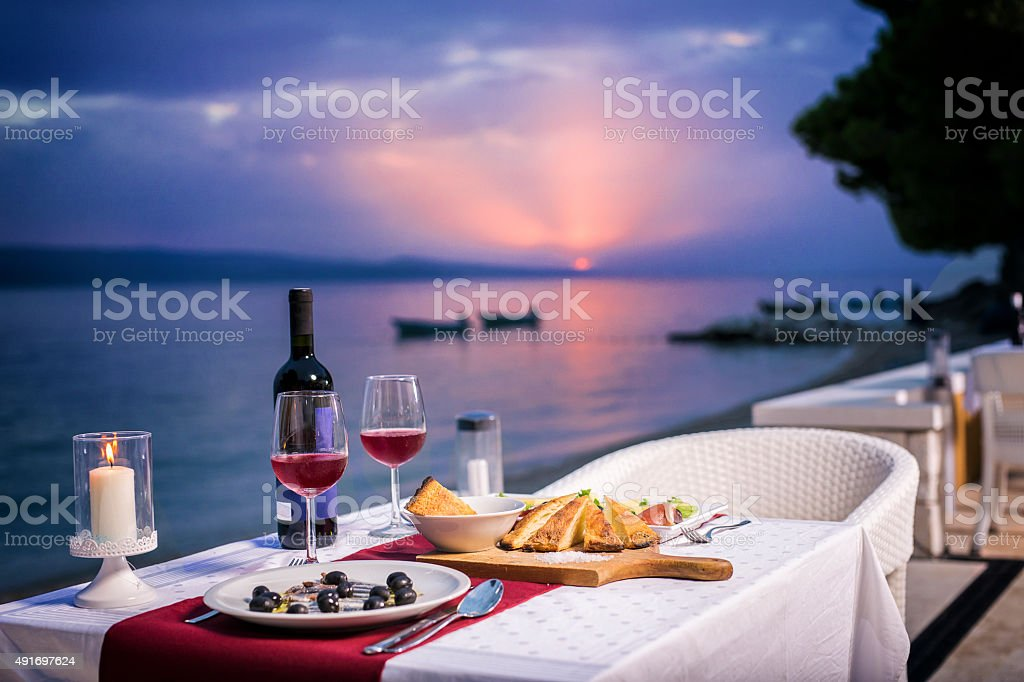 Romantic dinner in sunset time stock photo