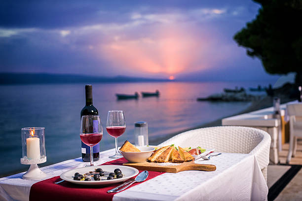 Romantic dinner in sunset time Romantic dinner in sunset time for two table for two stock pictures, royalty-free photos & images