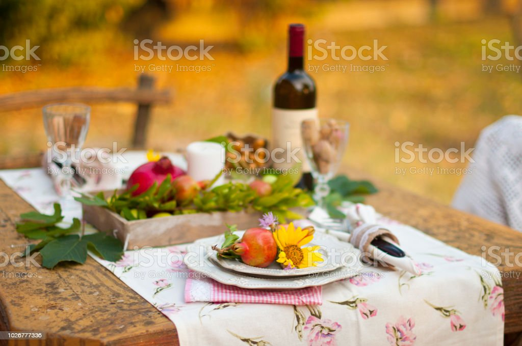 Romantic dinner in the autumn garden, table setting for a nice...