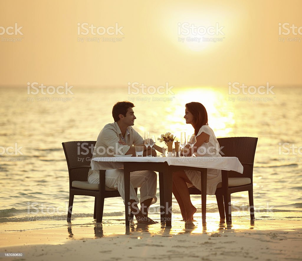 Romantic dinner in the waves royalty-free stock photo