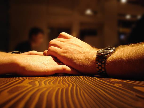 romantic dinner - love couple holding hands - fsachs78 stockfoto's en -beelden
