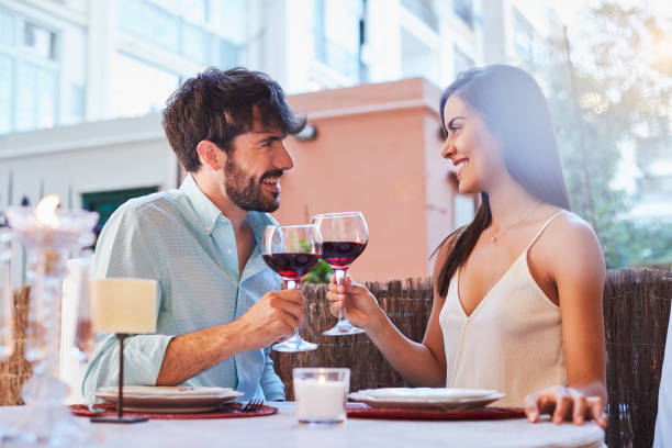 Romantic dinner lifestyles in Barcelona home one woman table for two stock pictures, royalty-free photos & images