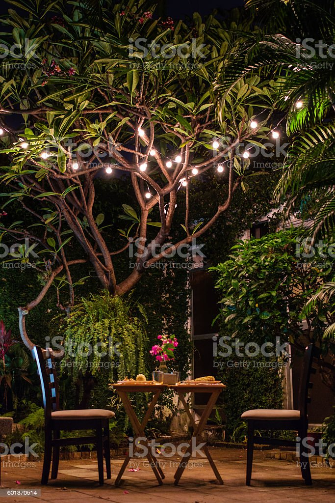 Romantic dinner set up with lights stock photo