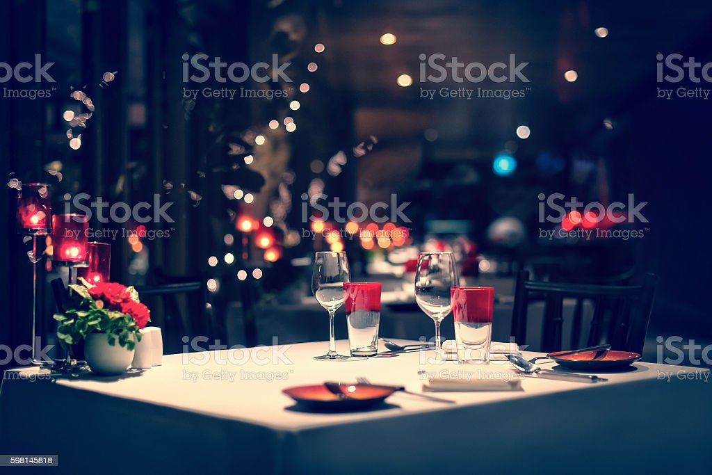 romantic dinner setup, red decorations. Vintage. stock photo