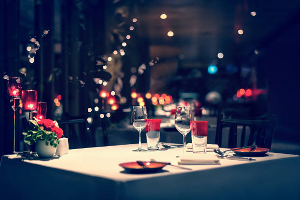 romantic dinner setup, red decorations. Vintage. - foto stock