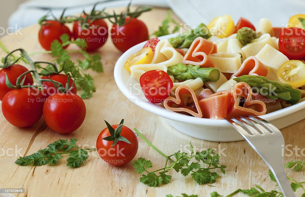 Romantic dinner with pasta and tomatoes royalty-free stock photo