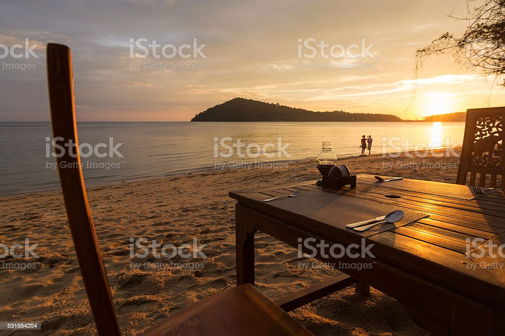 Romantic dinner with sunset, beach and ocean on Koh Chang stock photo