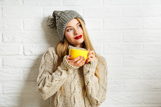 romantic dreaming winter hipster girl with a mug - styles stock photos and pictures