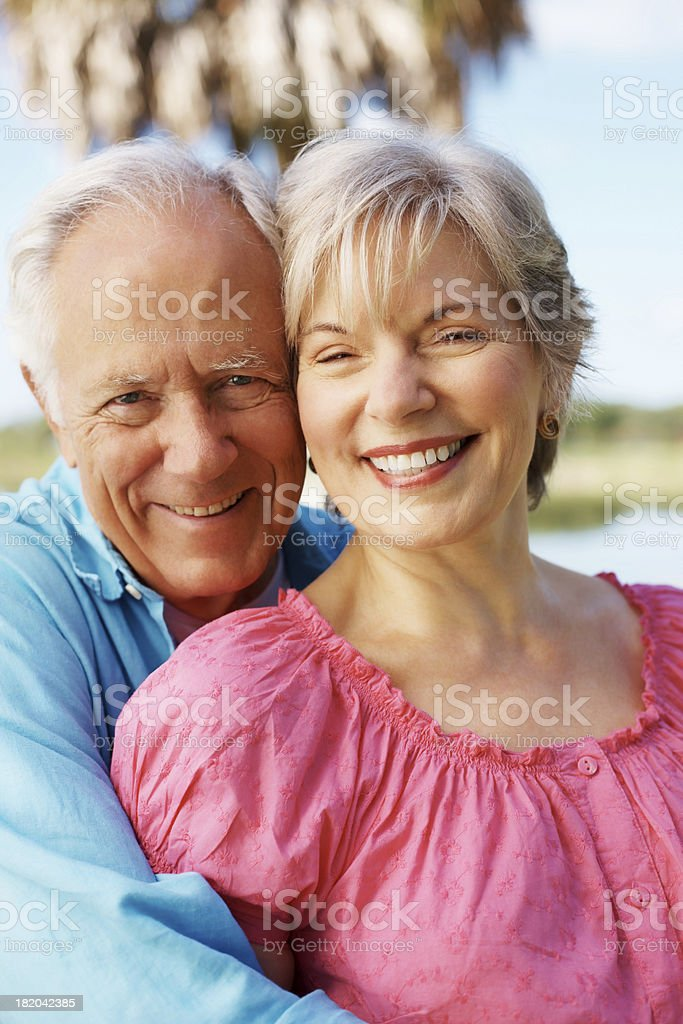 Romantic, elderly couple smiling together royalty-free stock photo