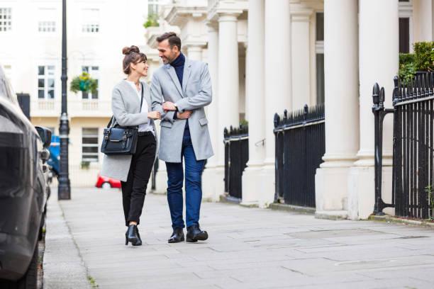Romantic elegant couple walking in the city street in London stock photo