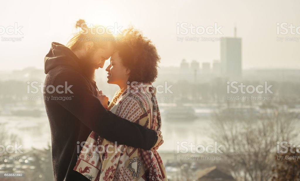 Romantic embracing loving couple. Falling in love stock photo