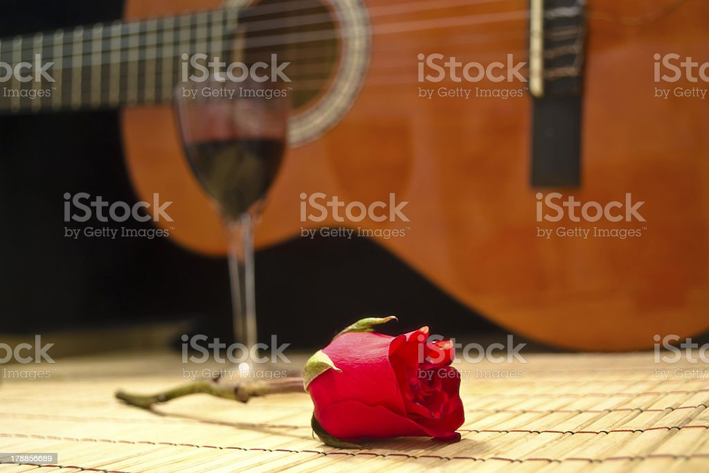 romantic evening glass of vine rose and classical guitar stock photo