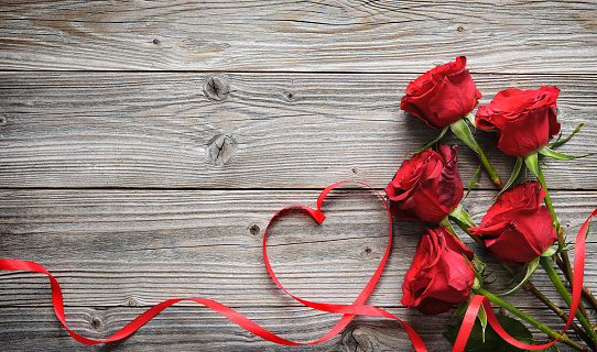 Romantic Floral Frame With Red Roses And Ribbon On Wooden Background Stock Photo - Download Image Now