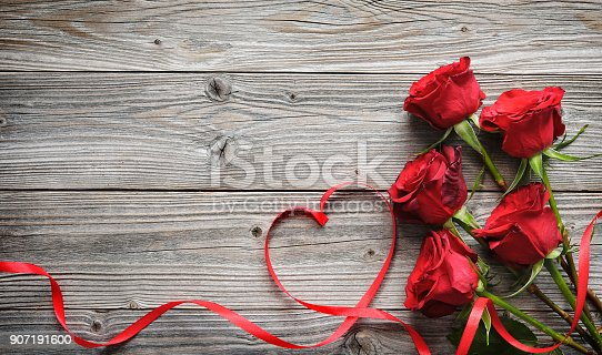 Romantic Floral Frame With Red Roses And Ribbon On Wooden Background Stock Photo & More Pictures of Above