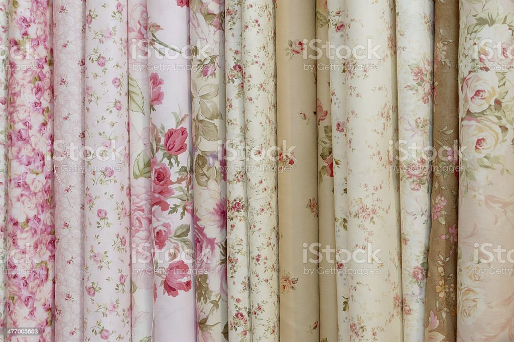 romantic flowery printed rolls of cloth royalty-free stock photo