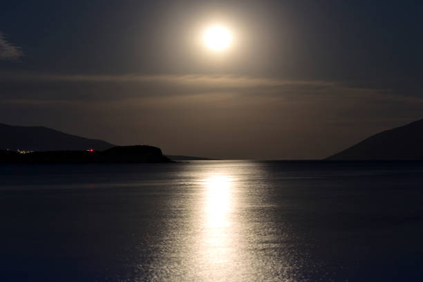 a romantic full moon rise at bodrum, turkey - romantic moon stock photos and pictures