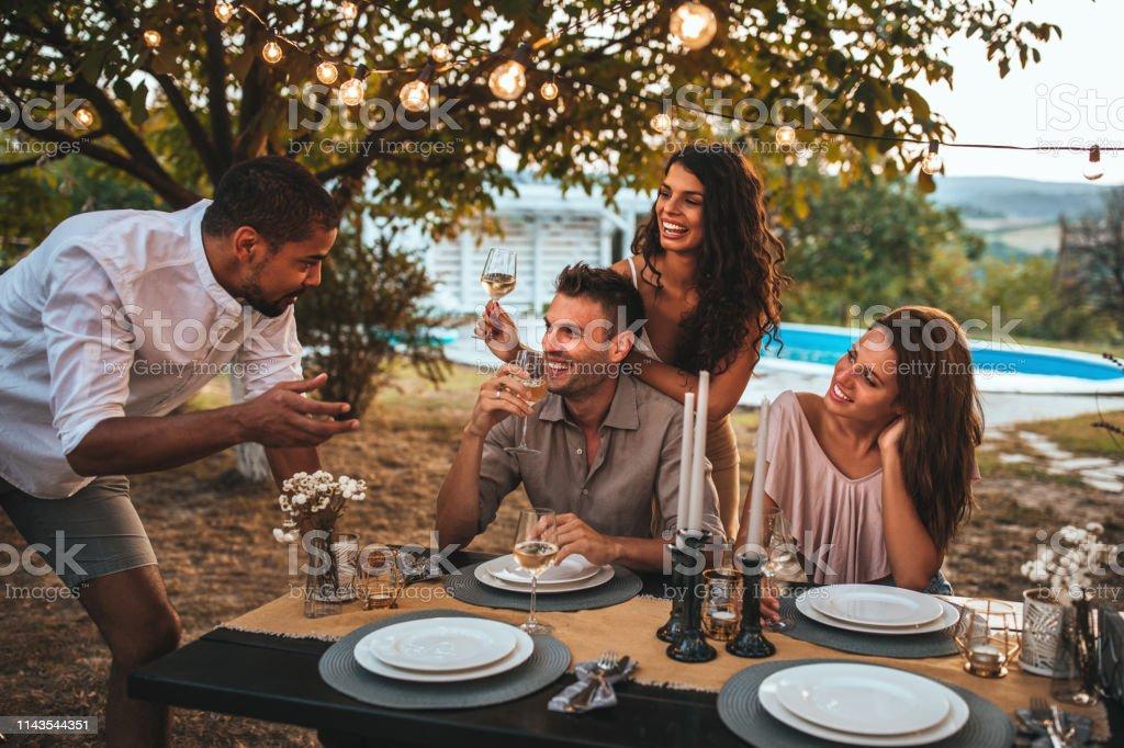 Group of friends having dinner in the garden