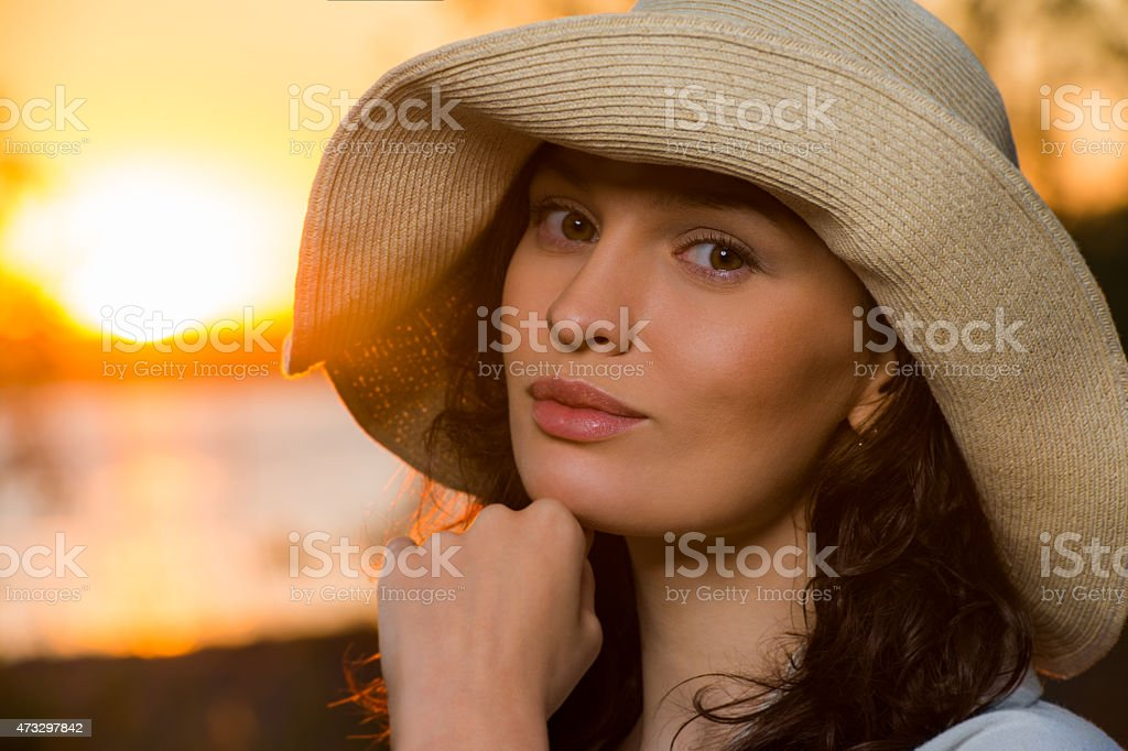 Romantic girl on the beach during sunset stock photo