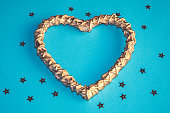 istock Romantic golden woodenheart on the blue background with stars 1086341482