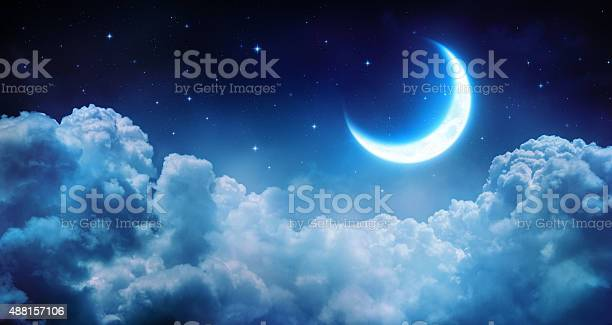 Photo of romantic half moon on the clouds