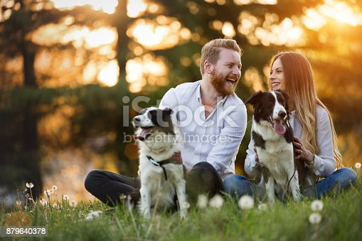 istock Romantic happy couple in love enjoying their time with pets 879640378