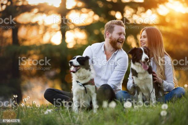 Romantic happy couple in love enjoying their time with pets picture id879640378?b=1&k=6&m=879640378&s=612x612&h=iwzvd7azldc8isewdryac9aj5iutssddfe2rb zufx8=