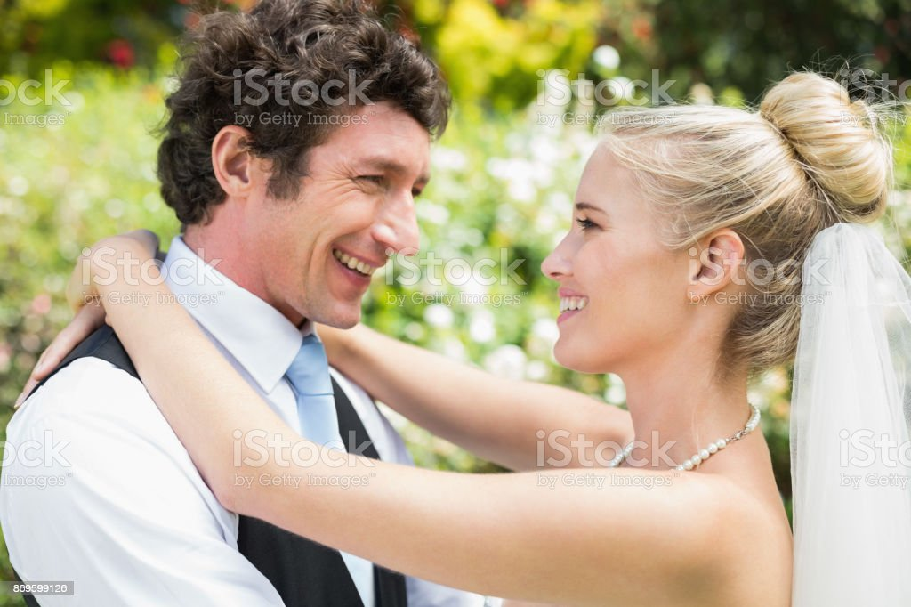 Romantic happy newlywed couple hugging each other stock photo