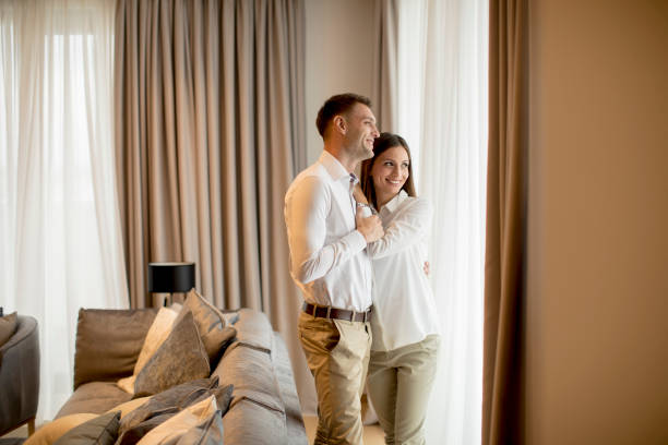 Romantic happy young couple relax at modern home interior stock photo