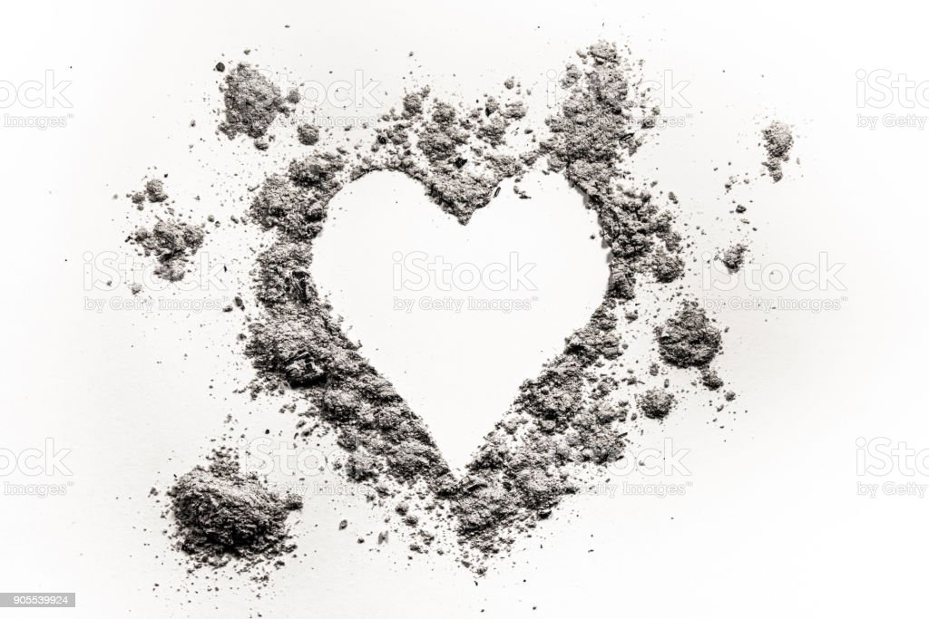 Romantic heart love symbol made in ash, dust or sand stock photo