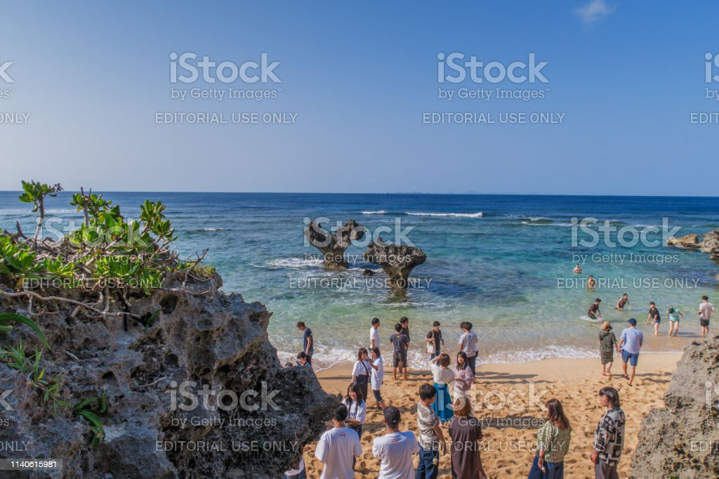Romantic heart rock of Kouri Island Okinawa The heart-shaped rocks formed through erosion are a popular attraction on Kouri Island. These rocks are set in the emerald colored sea on the South China Sea. Tourists descend a steep walkway to get to the famous beach. Awe Stock Photo